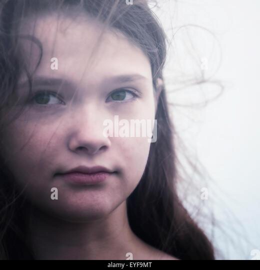 headshot of a young and sad teenage girl - Stock Image