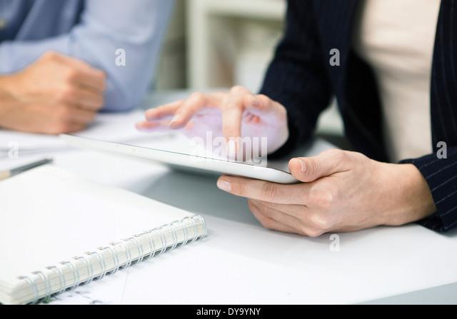Businesswoman using digital tablet, cropped - Stock-Bilder