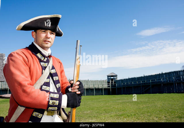 Mackinaw City Michigan Mackinac State Historic Parks Park Colonial Michilimackinac Musket Demonstration man soldier - Stock Image