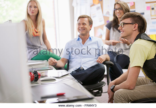 creative team in discussion in trendy office - Stock Image