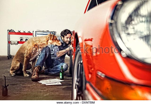 Man repairing his vintage car - Stock Image