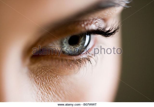 Detail of woman's face showing left eye - Stock Image