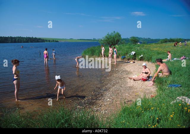Russia former Soviet Union Irma residents swim near junction of Sheksna & Irdomka Rivers - Stock Image