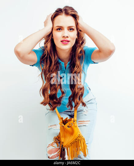 young pretty long hair woman happy smiling isolated on white background, wearing cute tiny fashion handbag, lifestyle - Stock Image
