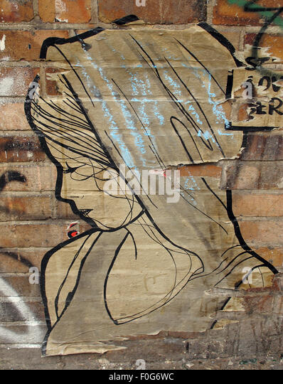 Berlin Mitte,Street art on walls,Germany - Girl in a shawl - Stock Image