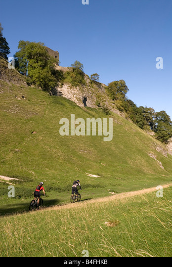 Mountain biking through Cavedale Castleton Peak District National Park Derbyshire England UK GB - Stock Image