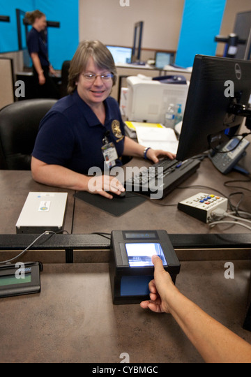 Customer in to renew driver's license gets finger-printed and completes eye exam at the Texas Department of - Stock Image
