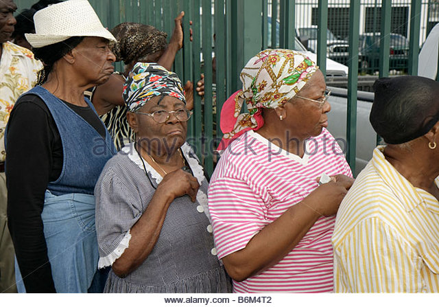 Miami Florida Little Haiti Thanksgiving Turkey Give-Away give away Haitian Black woman women senior assistance community - Stock Image