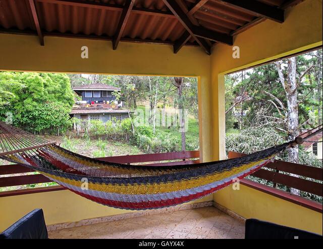Woven rope hammock terrace in vacation villa in Cerro Azul, Panama. - Stock Image