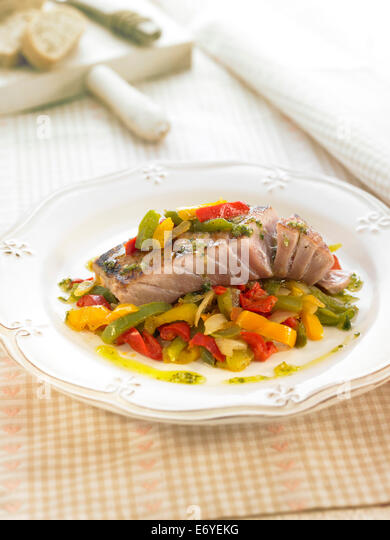 Tuna with three-colored bell peppers - Stock Image