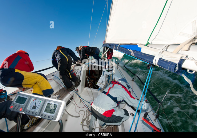 'Teamwork' as shown by an offshore yacht Racing crew. - Stock-Bilder