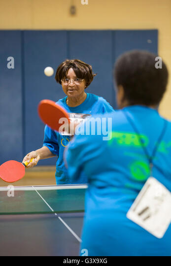 Detroit, Michigan - Table tennis competition at the Detroit Recreation Department's Senior Olympics. - Stock Image