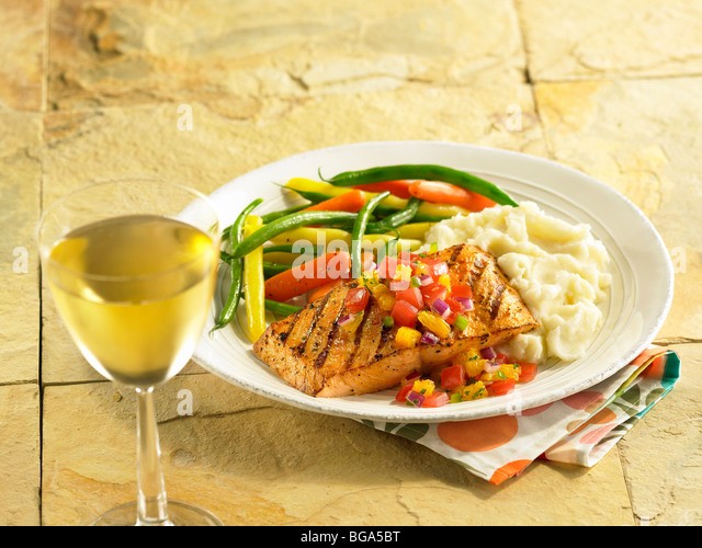 Grilled salmon with mashed potatoes and mixed vegetables - Stock Image