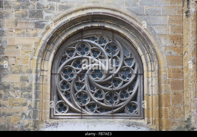 Spiral tracery in window of Bayonne Cathedral, France - Stock Image