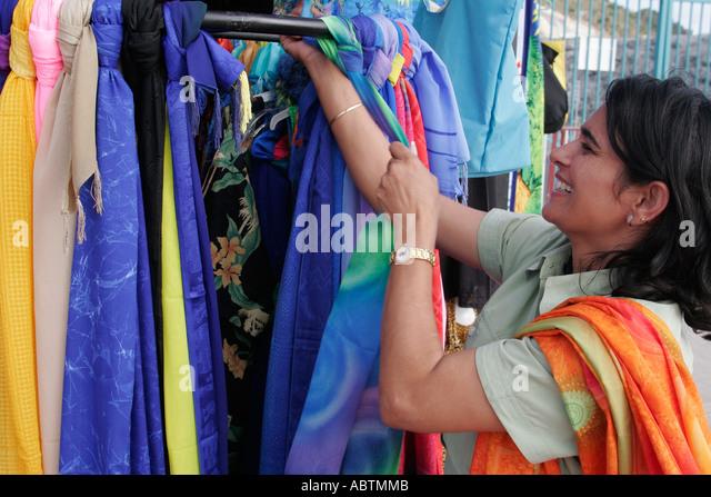 Sint Maarten Philipsburg Dutch Asian woman fabric for sale duty free - Stock Image