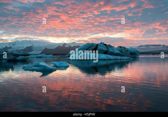 Dramatic sunset at Jokulsarlon Iceberg Lagoon, Vatnajokull National Park, Iceland. - Stock Image