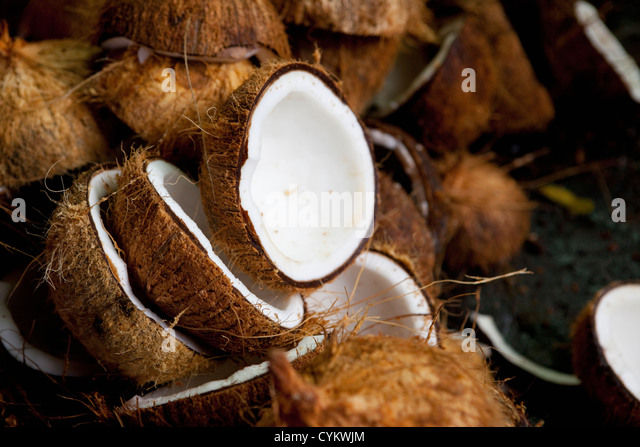 Close up of halved coconuts - Stock Image