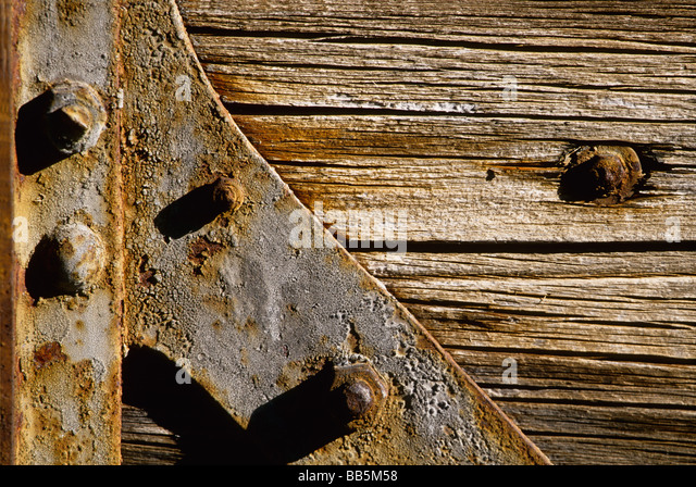 oxidized attach on an old wooden train door - Stock Image