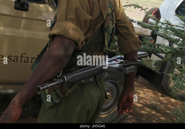 MARSABIT, KENYA - May 17.  An armed GSU officer on guard in a tourist convoy on the Isiolo to Lake Turkana road. - Stock Image