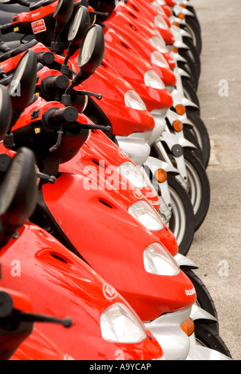 Bermuda row line red motor scooters - Stock Image