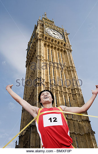 Athlete at finish line by big ben - Stock Image