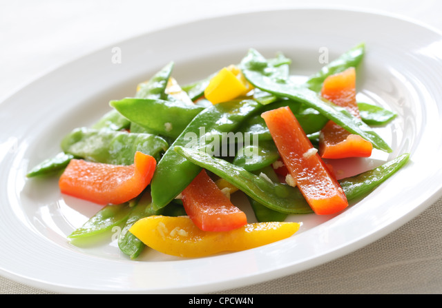 Ginger snow peas and peppers - Stock Image