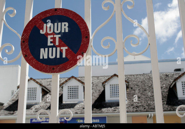 Saint Martin Marigot French no parking sign day and night gate - Stock Image