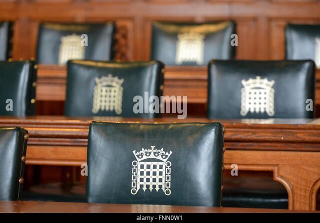 Chairs showing portcullis crest in a Palace of Westminster committee room - Stock Image