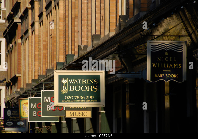 A row of signs for antiquarian bookshops in Cecil Court off Charing Cross Road. - Stock-Bilder