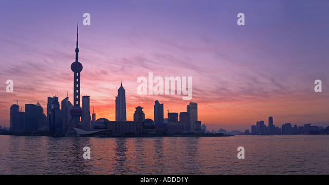 Oriental Pearl TV Tower with highrises in Pudong Area at sunrise Shanghai China - Stock Image