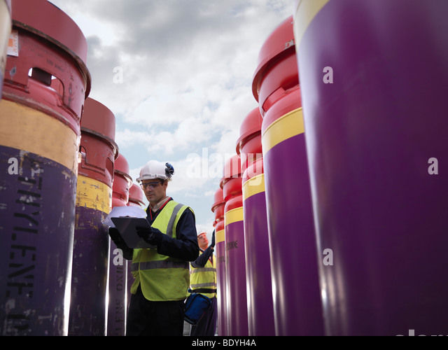 Port Worker With Clipboard & Containers - Stock Image