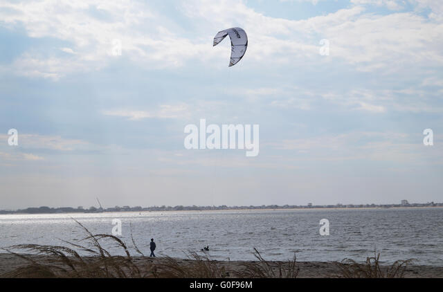 A man wind surfing in Plumb Beach. - Stock Image