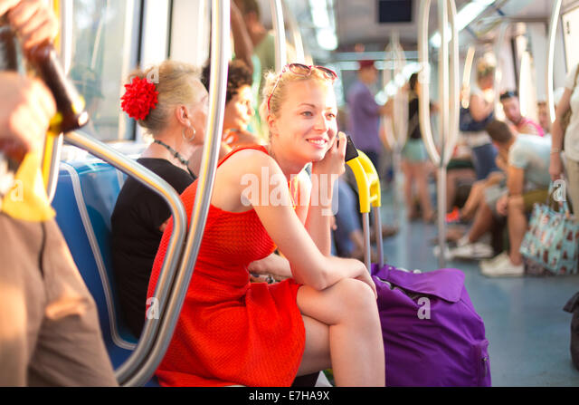 Lady traveling by metro. - Stock Image