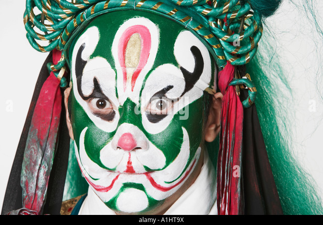 Portrait of a male Chinese opera performer looking serious - Stock Image