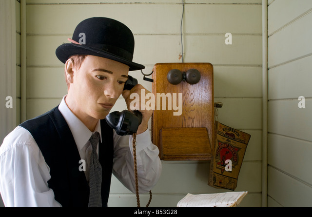 Old telephone at the Matakohe Kauri Museum, North Island, New Zealand - Stock Image