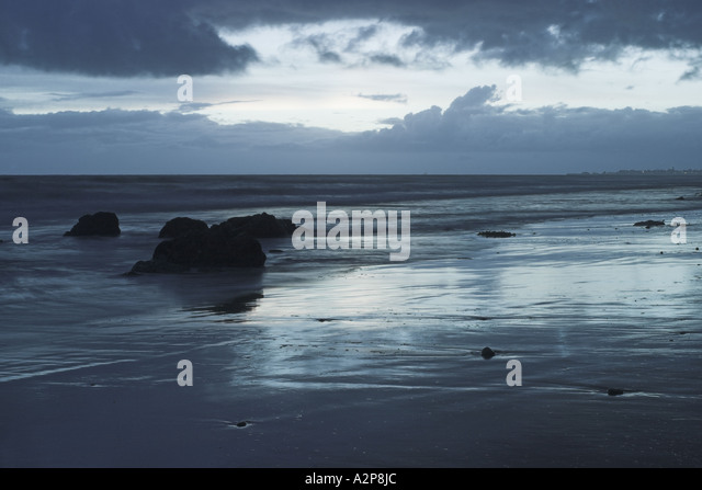 A cold dreary winter day at the beach. - Stock Image