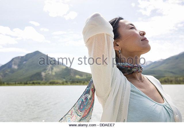 Mature woman enjoying the great outdoors - Stock Image
