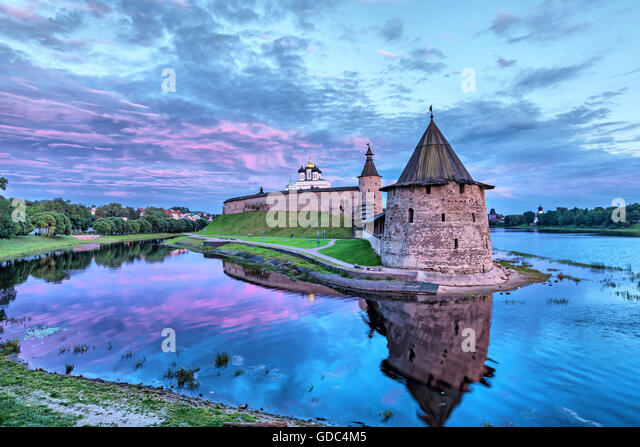 Purple evening sky over Pskov Kremlin and Ploskaya tower in front of view (HDR-effect) - Stock Image