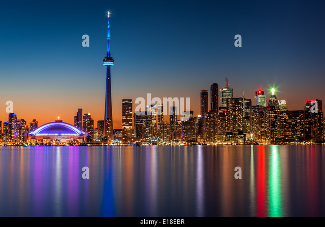 Toronto skyline at dusk, viewed from Toronto Island park - Stock Image