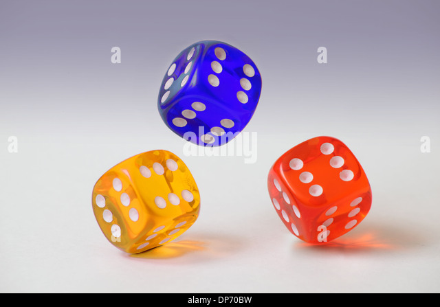 Three clear plastic dice with six on every face tumbling on a plain white graduated background. - Stock Image