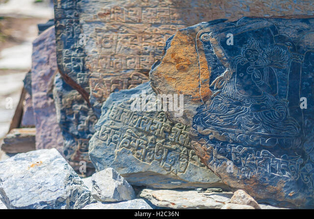 Closeup Photo Autentic Draw Stone Buddist Symbols and Mantras. Horizontal. Nepal Travel Trakking - Stock Image