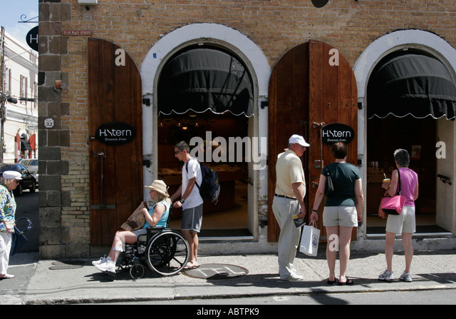 St. Thomas USVI Charlotte Amalie Main Street duty free shopping wheelchair disabled - Stock Image