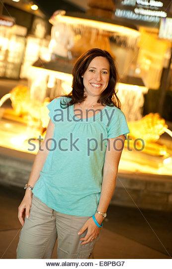 Woman standing next to fountain - Stock-Bilder