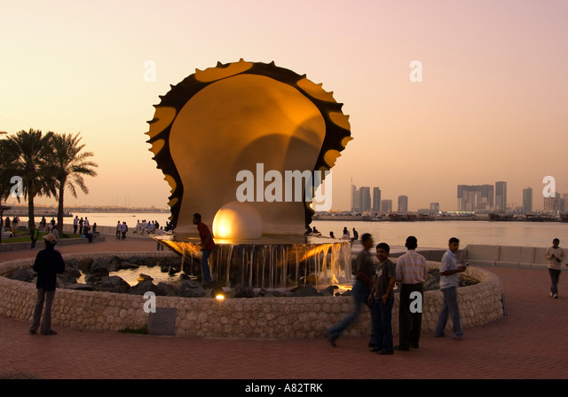 Qatar Doha oyster fountain with pearl along the shore of Doha at sunset - Stock Image