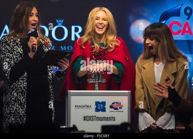 Oxford Street, London, UK. 1st November, 2015. Thousands watch as Kylie Minogue gets the festive season underway - Stock Image