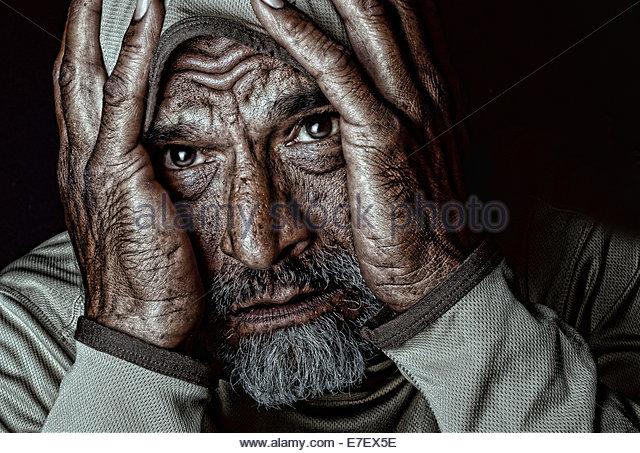 Emotional Image of a  Indian man on Black - Stock Image
