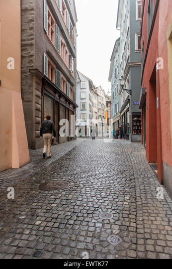 Narrow cobblestone lane with shops in Zurich Switzerland, Europe - Stock Image