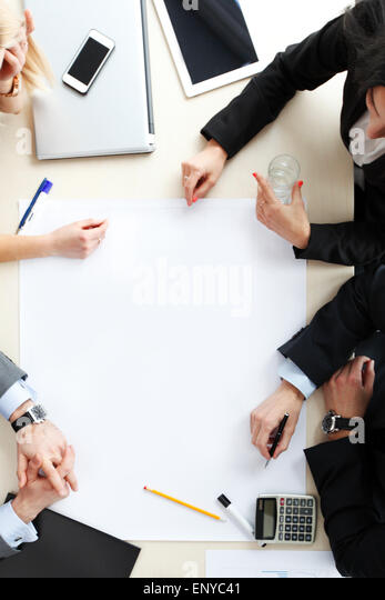 top view at business people at office desk - Stock Image