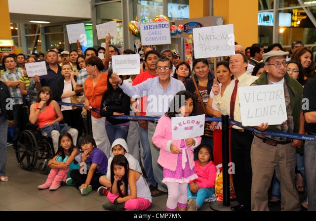 Lima Peru Jorge Chávez International Airport LIM passenger terminal arrivals chauffer driver name signs welcome - Stock Image