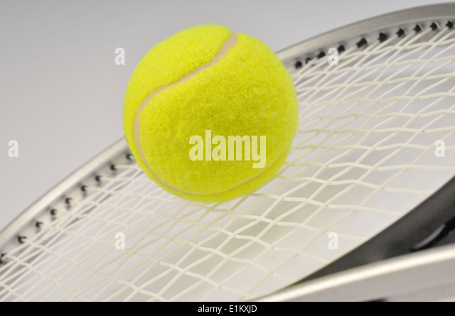 racket and tennis ball - Stock Image